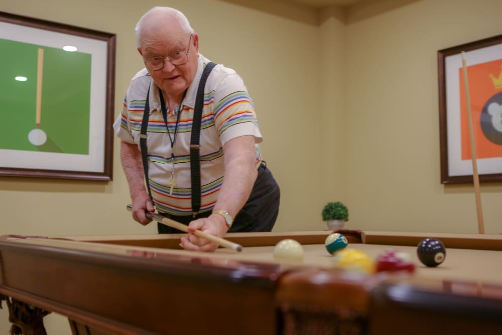 A resident playing billiards at Harmony at West Shore in Mechanicsburg, Pennsylvania