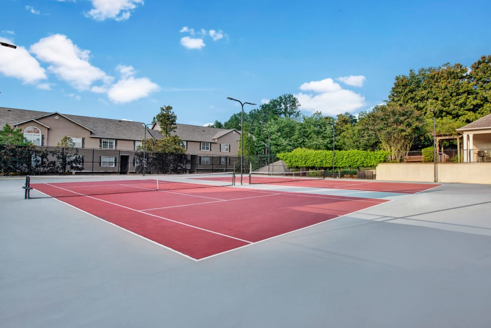 Well maintained tennis courts for resident use at Avia at North Springs in Atlanta, Georgia