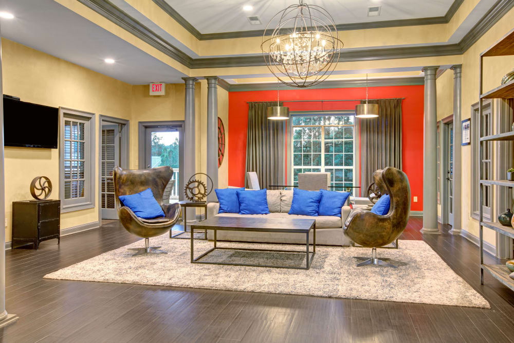 Clubhouse with modern seating and enjoyable hang out space for residents at Avia at North Springs in Atlanta, Georgia