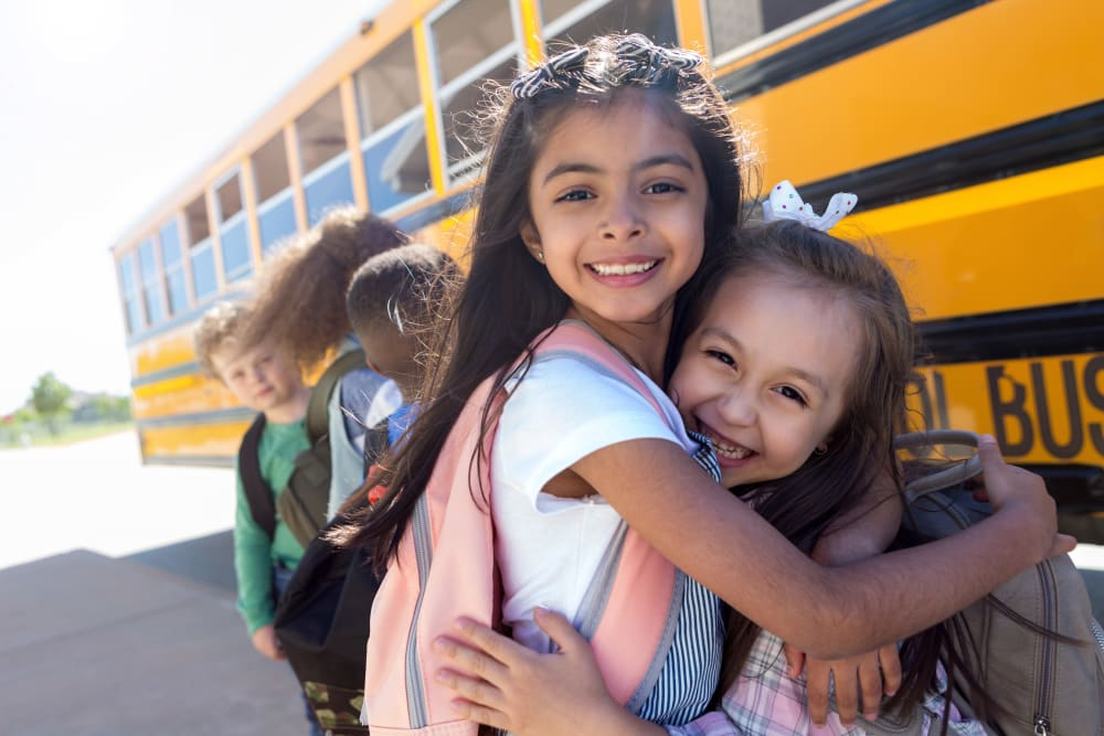 Resident children getting ready to get on a school bus near La Valencia Apartment Homes in Campbell, California