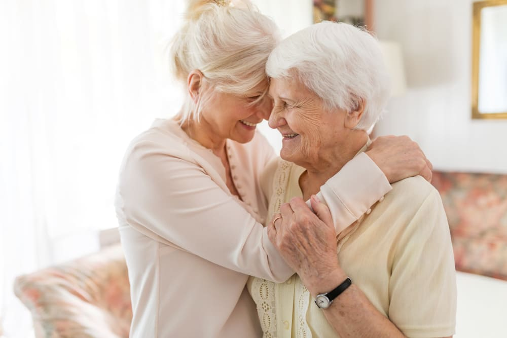 A resident and a lady hugging at Golden Living in Taylorsville, Utah.