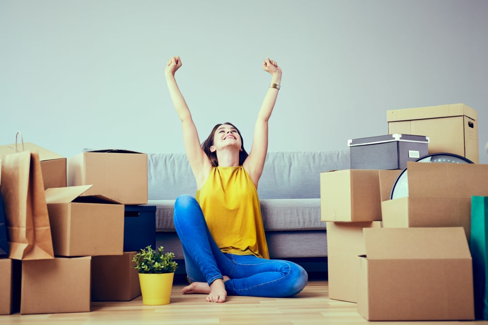 A woman stretching from packing boxes near Trojan Storage in Vancouver, Washington