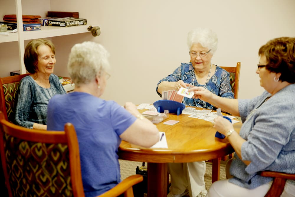 A group of residents playing a card game at Providence Assisted Living in Clarksville, Arkansas.
