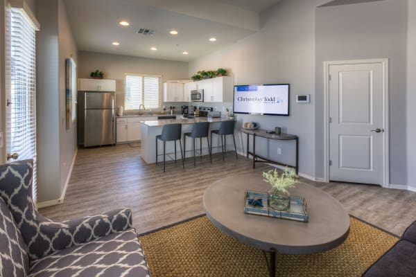 Open-concept layout with hardwood floors at Christopher Todd Communities at Country Place in Tolleson, Arizona