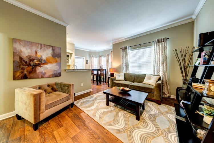 Open-concept layout with hardwood floors and accent walls in a model home at Baypoint in Corpus Christi, Texas