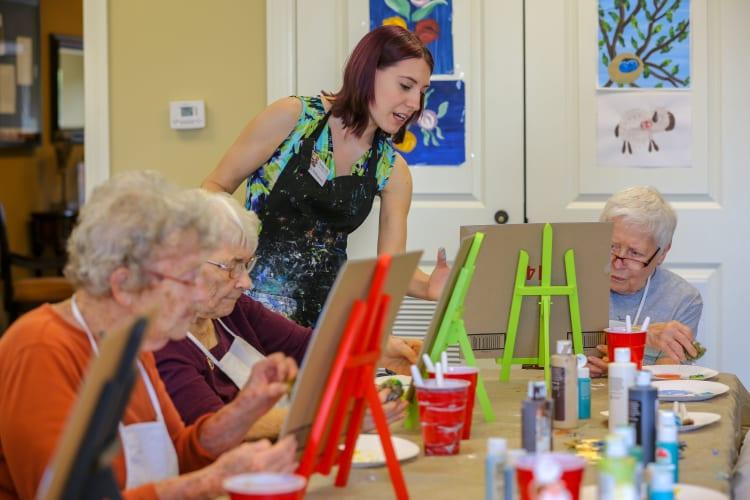 Residents enjoy a painting class at Harmony at Brookberry Farm in Winston-Salem, North Carolina