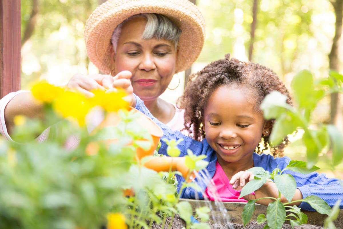 Resident and her granddaughter gardening at Magnolias of Chesterfield in Chester, Virginia