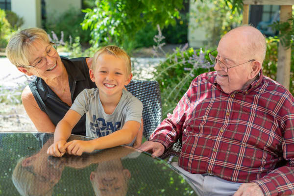 Senior citizen enjoying a moment with her grandson at Merrill Gardens at Brentwood in Brentwood, California
