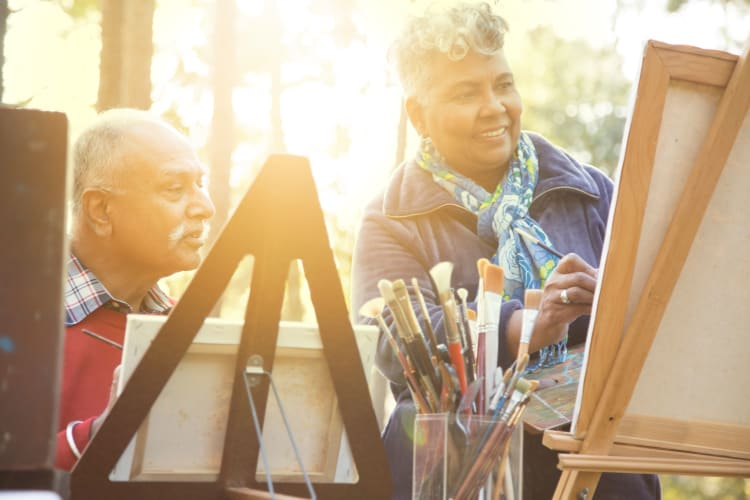 Residents painting together at Autumn Grove Cottage at Stone Oak in San Antonio, Texas