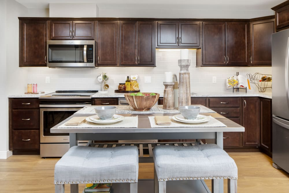A beautiful kitchen with and island at Touchmark on Saddle Drive in Helena, Montana