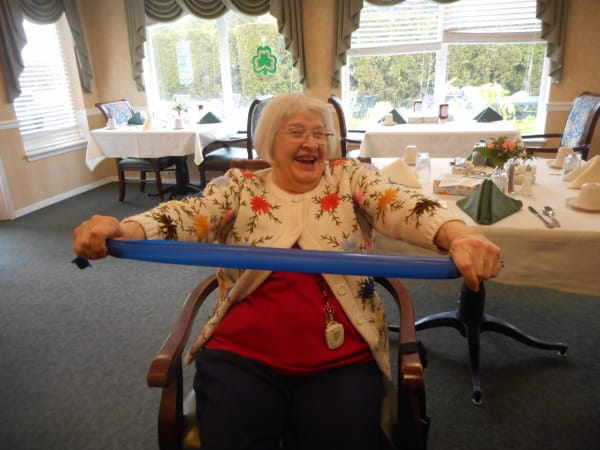 A resident in a fitness class at Patriots Glen in Bellevue, Washington.