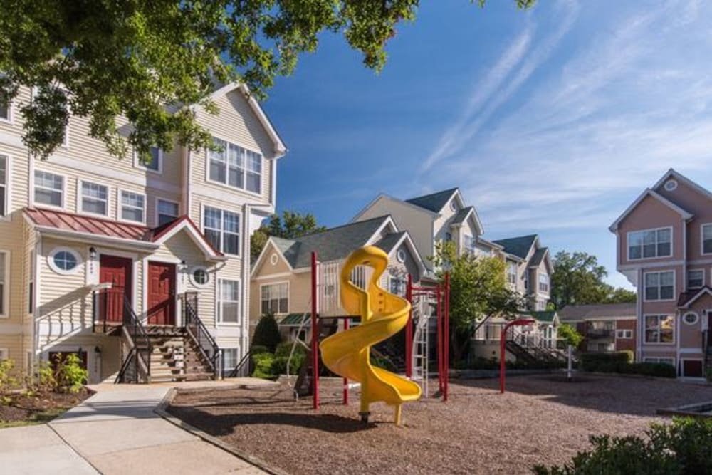 Beautiful children's playground with a slide at The Glen Apartments in Wheaton, Maryland
