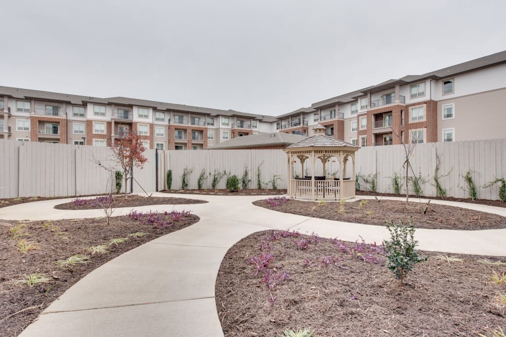 A paved walkway in the courtyard at Harmony at Oakbrooke in Chesapeake, Virginia