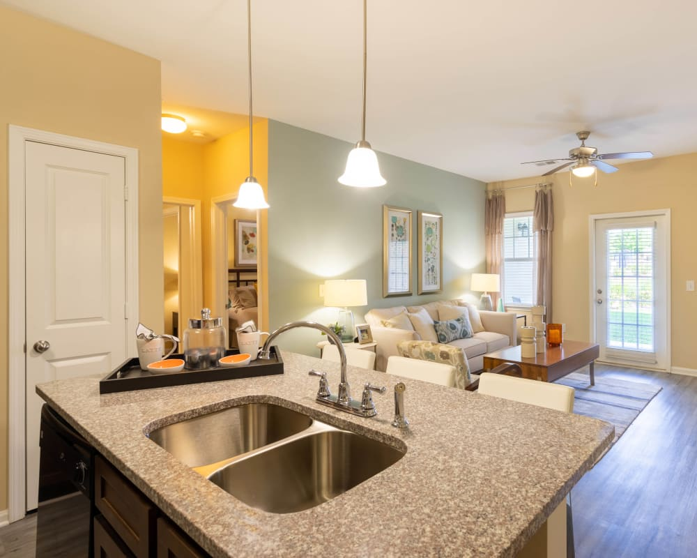 View of the living area from the open-concept kitchen in a model home at Legends at White Oak in Ooltewah, Tennessee