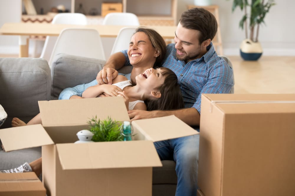 Family preparing items for storage in Sunnyvale, California at Devon Self Storage