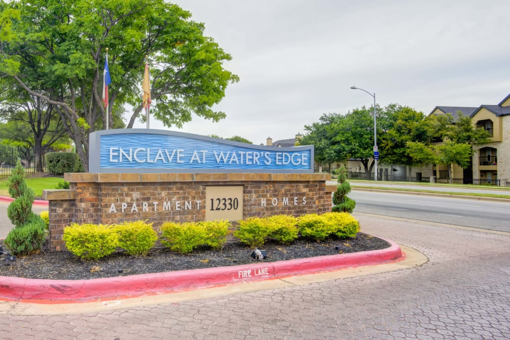 Enjoy apartments with a sign at Enclave at Water's Edge Apartments in Austin, Texas