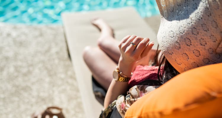 Resident relaxing poolside at Azul at Spectrum in Gilbert, Arizona