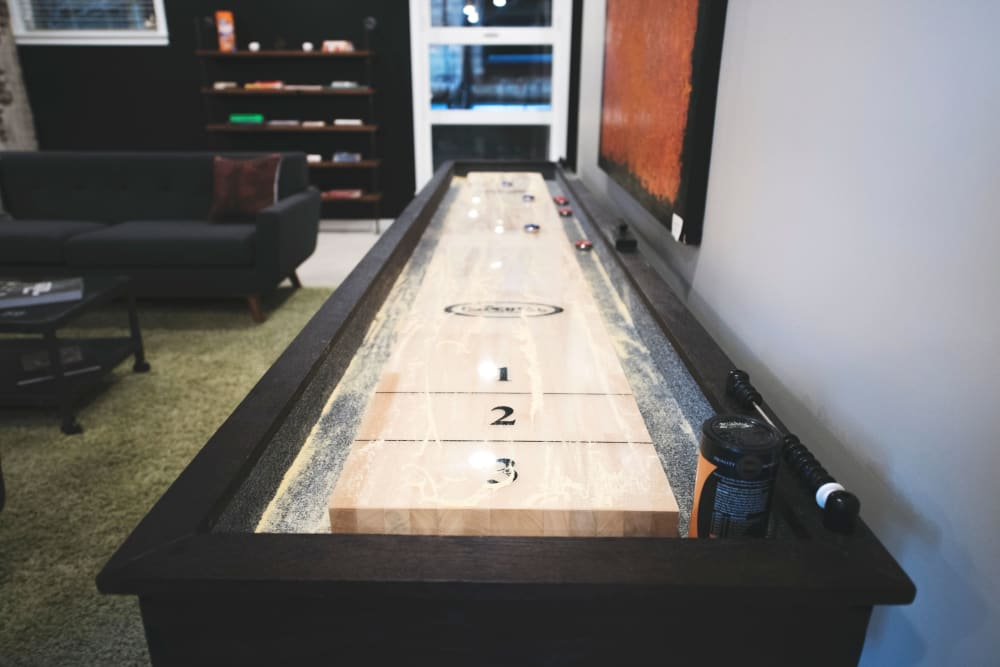 Tabletop shuffleboard and more in the clubhouse game room at Brooklyn Yard in Portland, Oregon