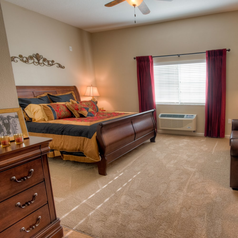 Model bedroom at Inspired Living at Royal Palm Beach in Royal Palm Beach, Florida