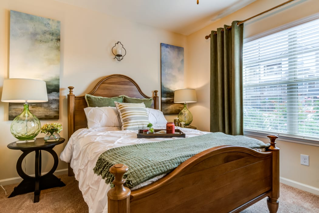 Bedroom with large windows in a model home at Commonwealth at 31 in Spring Hill, Tennessee