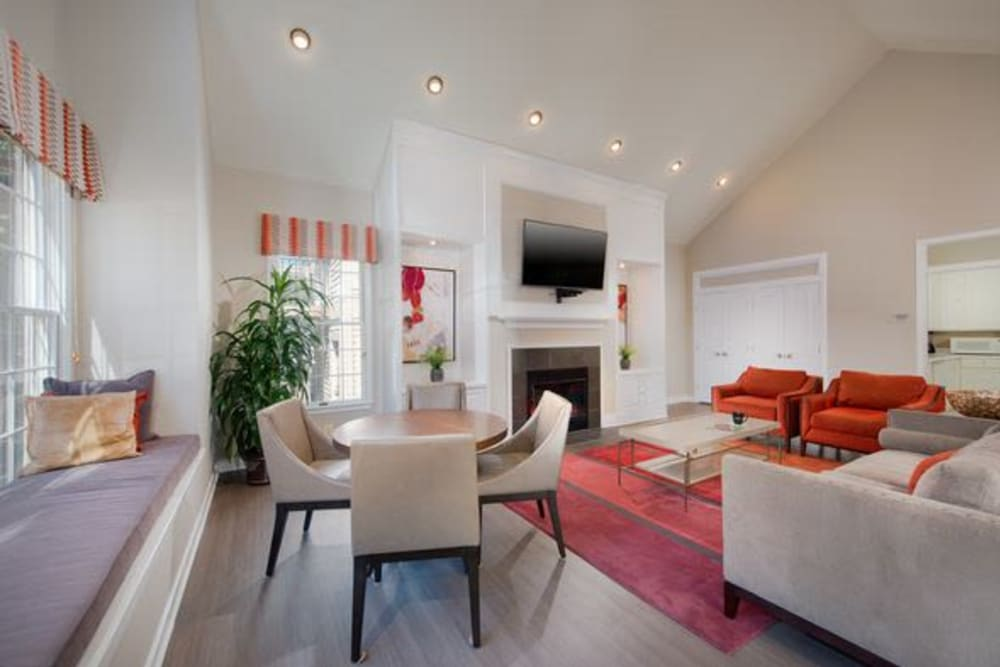 Beautiful clubhouse with plenty of comfortable seating at The Glen Apartments in Wheaton, Maryland