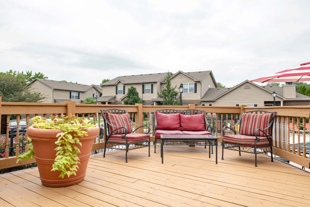 Comfortable outdoor seating next the pool at Cooper Creek in Louisville, Kentucky