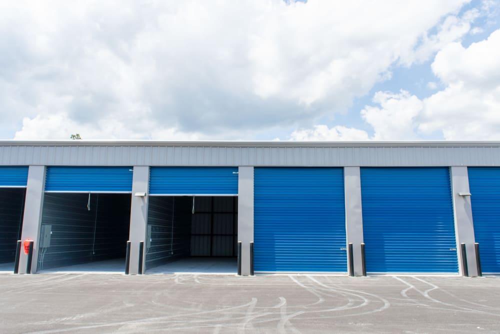 Open roll-up doors on outdoor storage at Atlantic Self Storage in Jacksonville, Florida