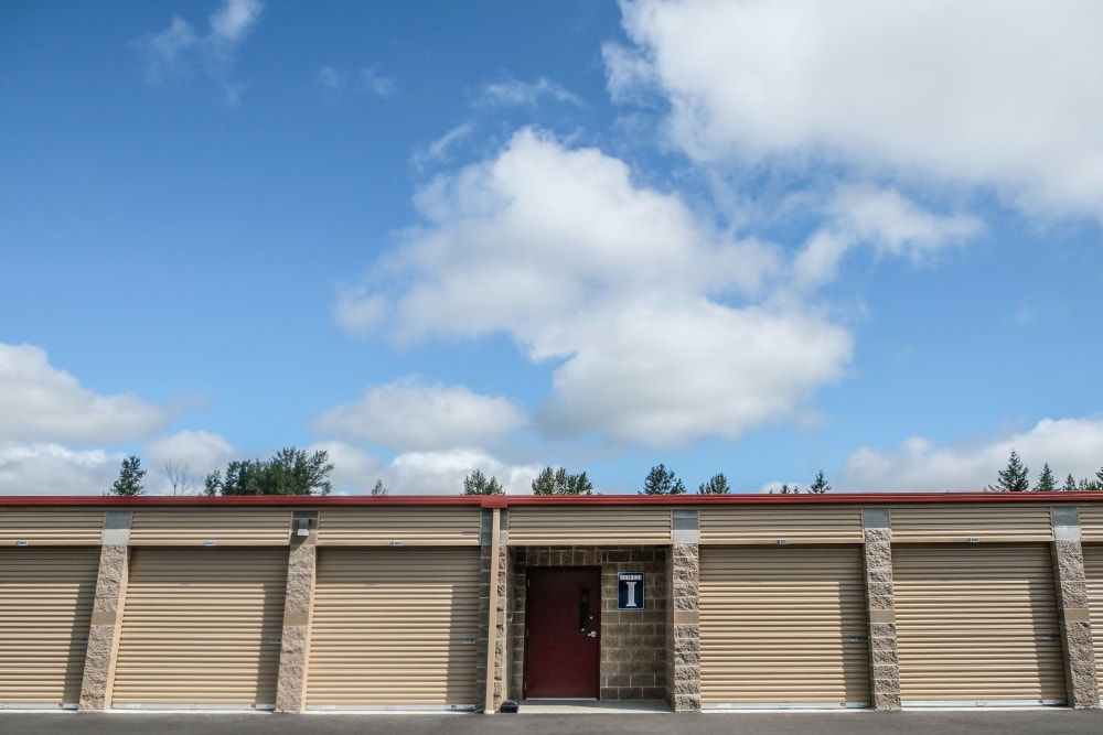 Exterior units with blue sky and clouds at Urban Self Storage Enumclaw - Phase II