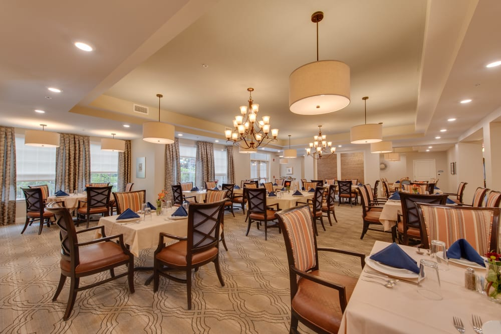 A well decorated dining room tables at Harmony at Harbour View in Suffolk, Virginia
