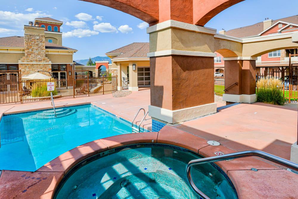 Hot tub and swimming pool at Bella Springs Apartments in Colorado Springs, Colorado
