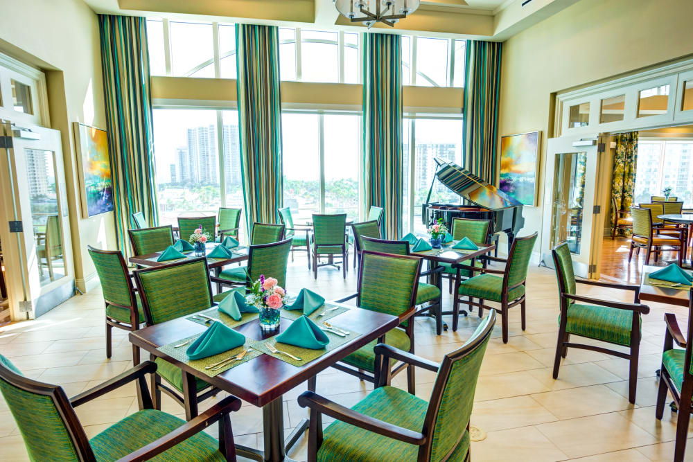 Dining room with big windows at The Meridian at Waterways in Fort Lauderdale, Florida.