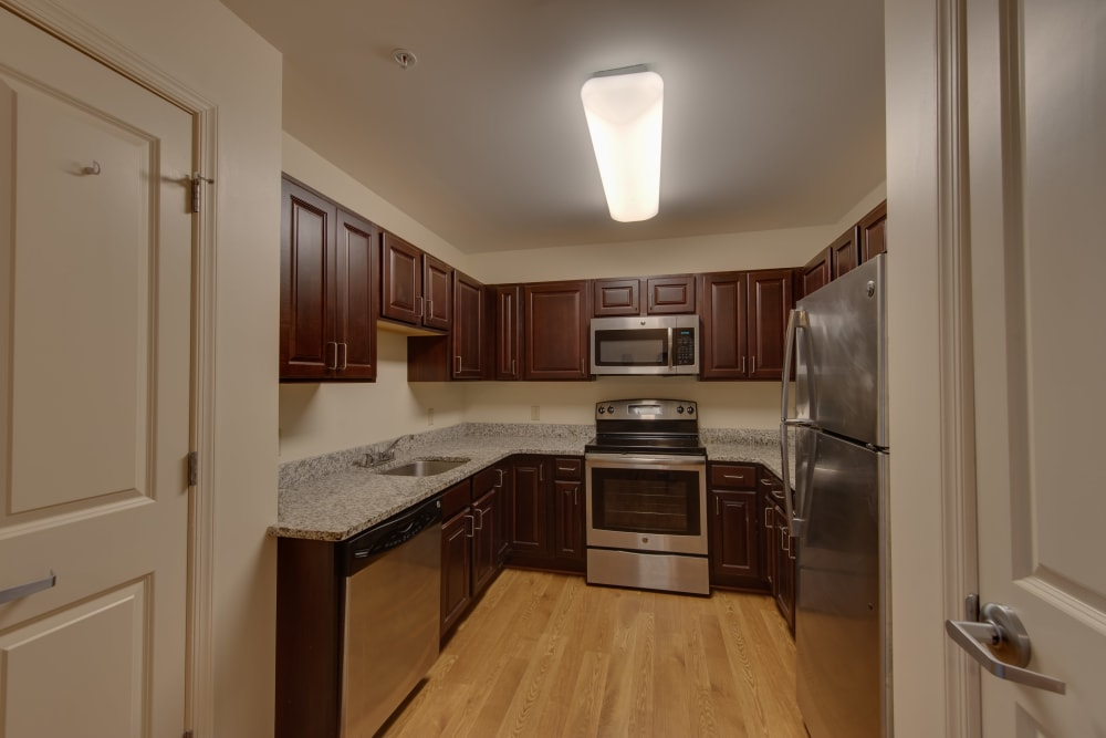 Stainless steel appliances in an apartment kitchen at Harmony at Harbour View in Suffolk, Virginia