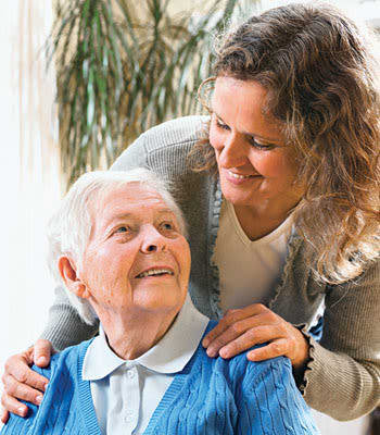 Caretaker helping a resident at West Fork Village in Irving, Texas