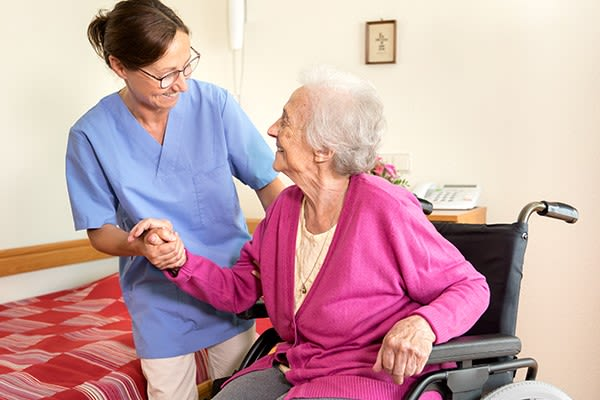 A caretaker assisting a resident at Heritage Senior Living in Blue Bell, Pennsylvania