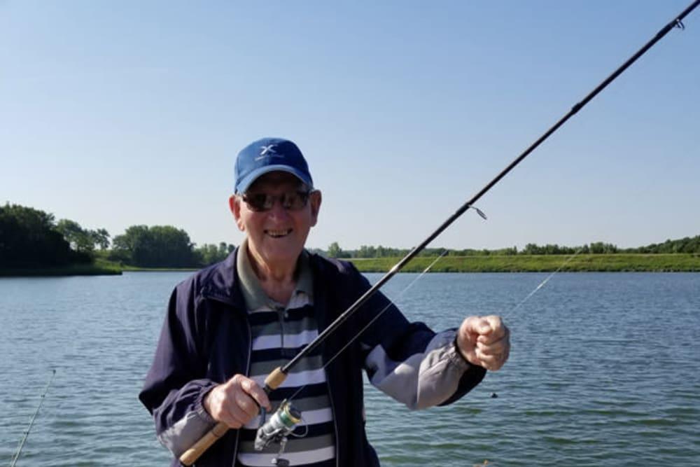 Resident fishing near The Lakeside Village in Panora, Iowa.
