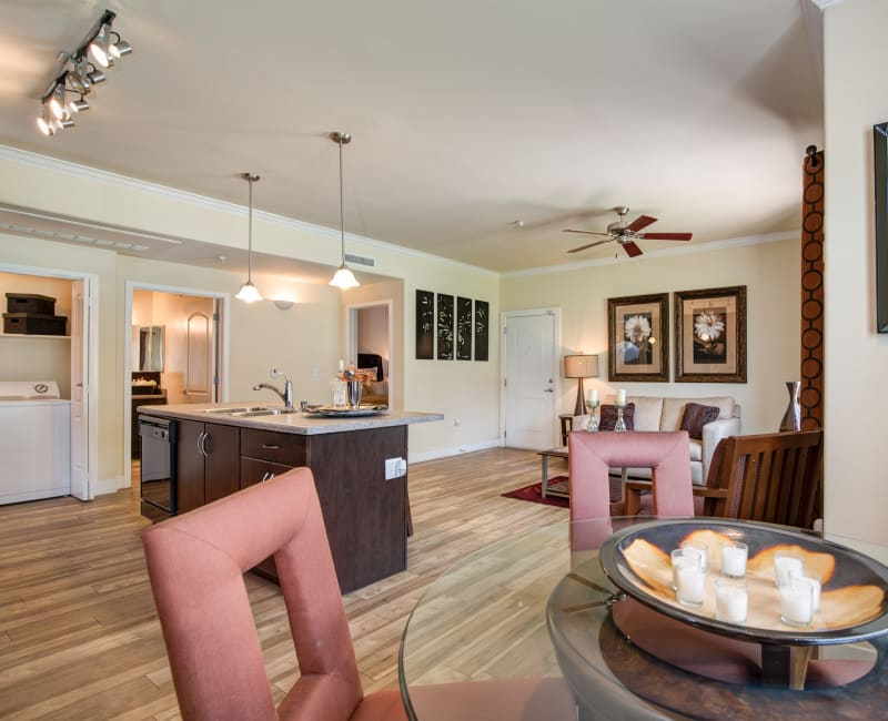 Bright and spacious open-concept layout with hardwood floors in a model home at Broadstone Towne Center in Albuquerque, New Mexico