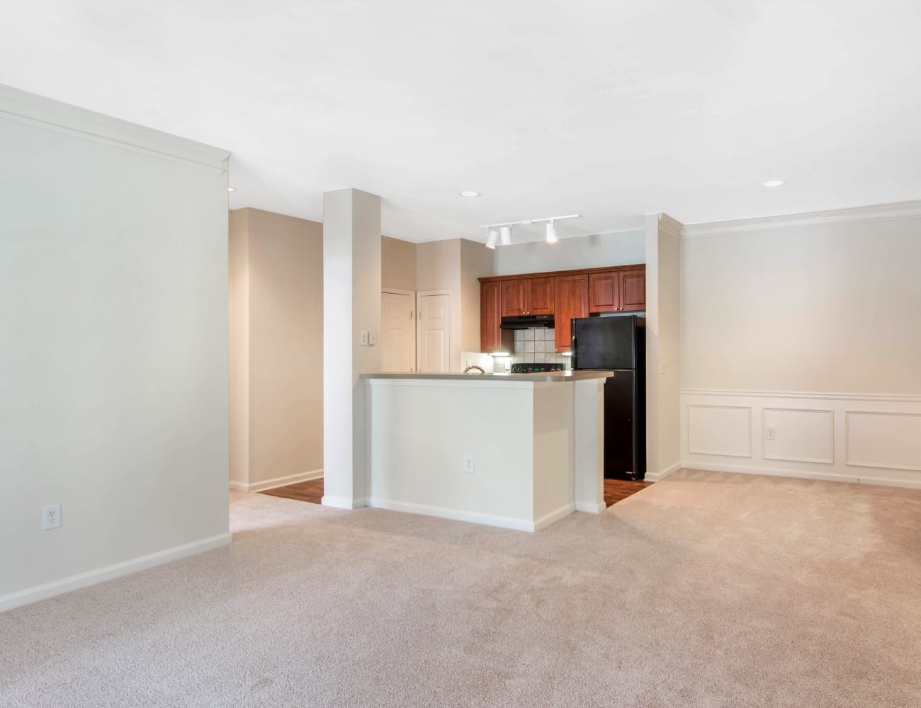 Open-concept layout with hardwood floors at Cavalier @ 100 in Lithonia, Georgia