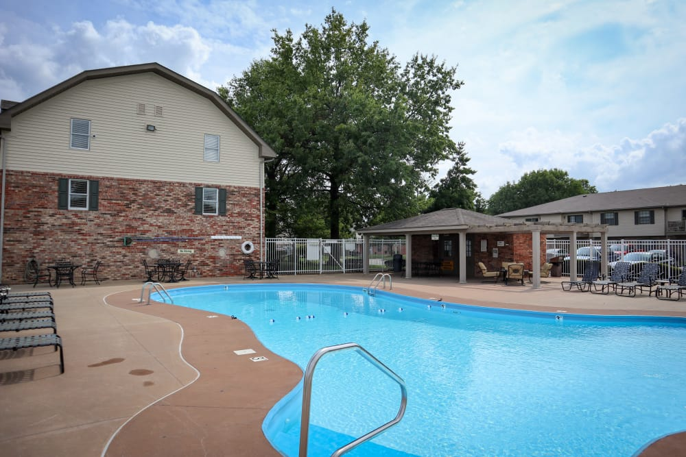 Beautiful swimming pool at Village Green Apartments in Evansville, IN