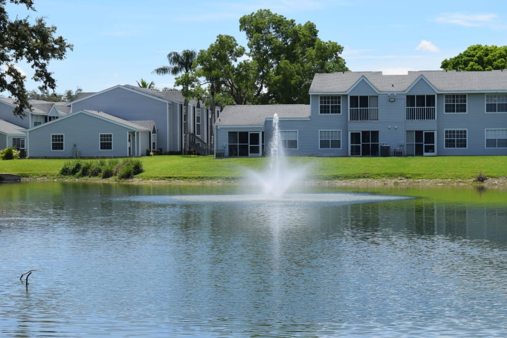 Backyard pond at Waverley Place apartments in Naples