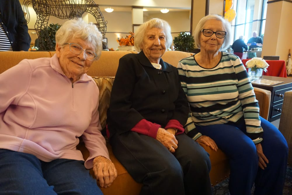 Ladies relaxing on the couch at our senior living community in Kirkland, WA
