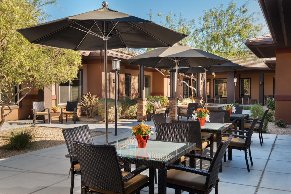 Covered outdoor seating at Avenir Memory Care at Scottsdale in Scottsdale, Arizona