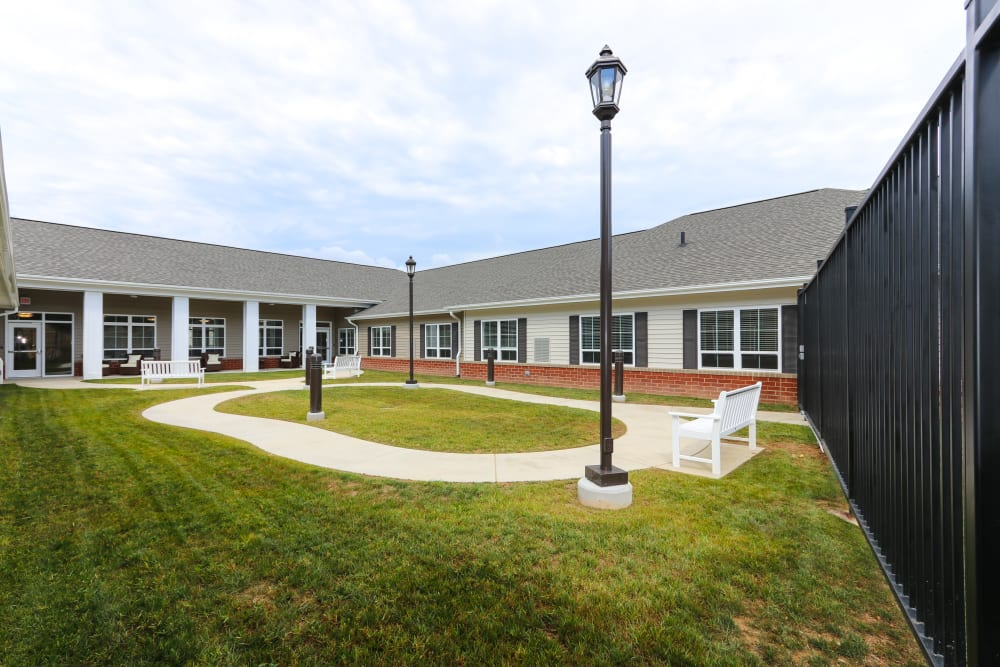 A paved walkway around the courtyard at The Harmony Collection at Roanoke - Memory Care in Roanoke, Virginia