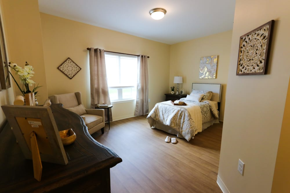A bedroom at The Harmony Collection at Roanoke - Memory Care in Roanoke, Virginia