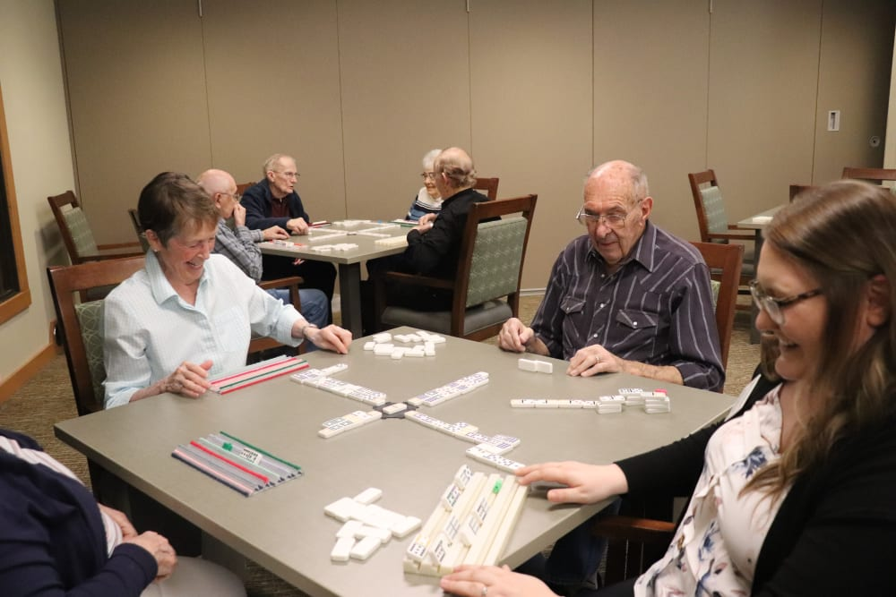 Residents playing dominos at The Springs at Greer Gardens in Eugene, Oregon.