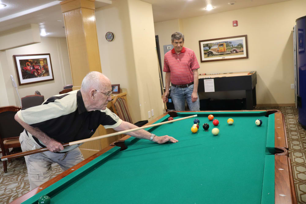 Residents playing billiards at The Springs at Sunnyview in Salem, Oregon