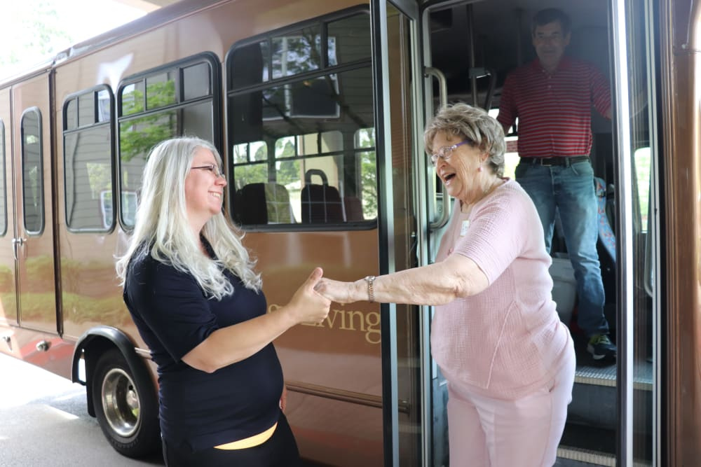 Resident being helped off the community transport bus at The Springs at Sunnyview in Salem, Oregon