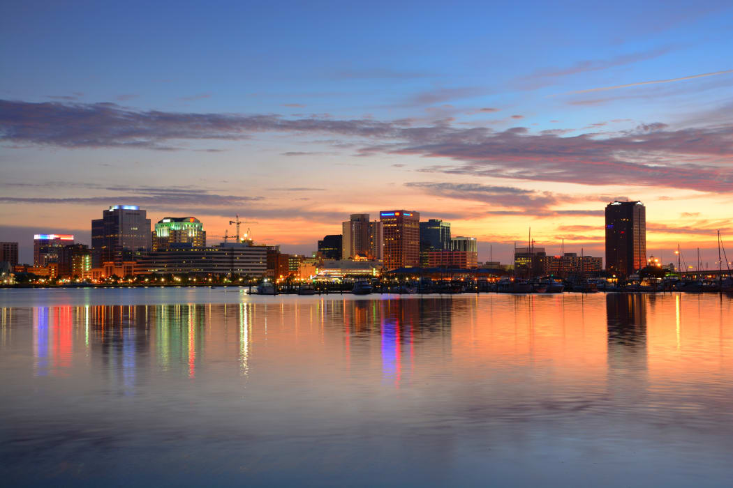 Beautiful view of downtown Hampton across the water in the evening in Hampton, VA