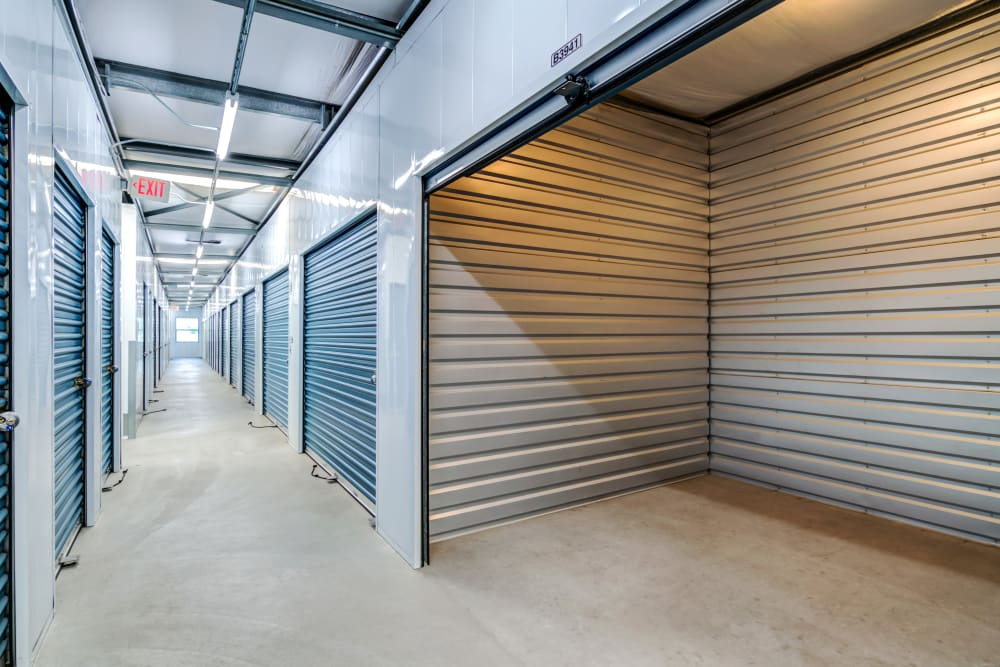 Large interior units with lights at Golden Triangle Self Storage