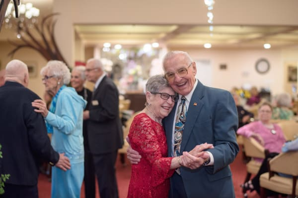 An elderly couple dancing at Glenmoore Gracious Retirement Living in Happy Valley, Oregon