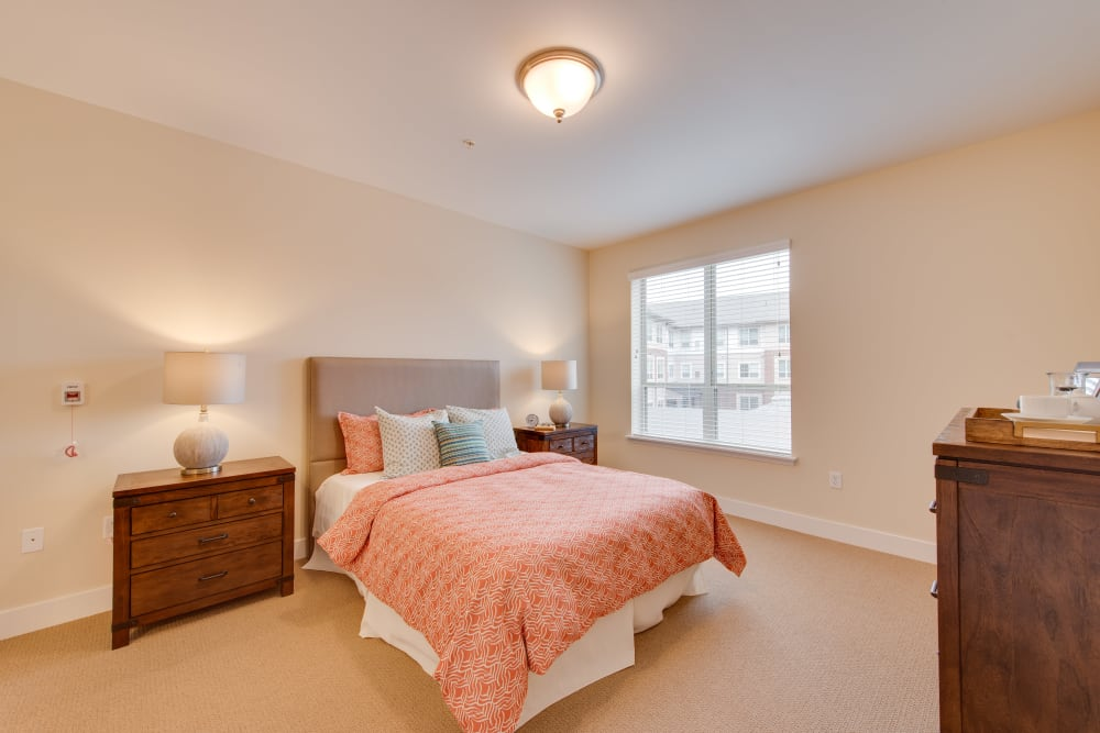 A large, furnished bedroom at Harmony at Oakbrooke in Chesapeake, Virginia